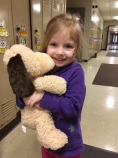 Photo of female student hugging a stuffed dog
