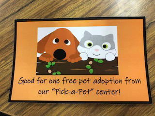 "Coupon for 1 free ""Pet Adoption"""