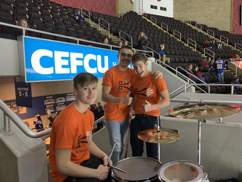 3 Male Pep Band students at Peoria Rivermen Game