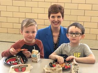 Principal Baney eating with 2 male Belle students