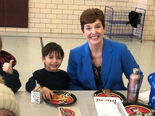 Principal Baney eating Pizza with male Belle student