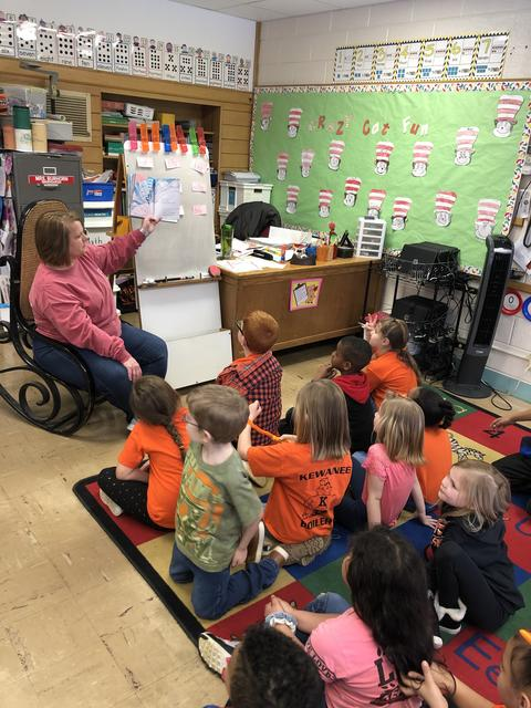 Burhorn reading to class