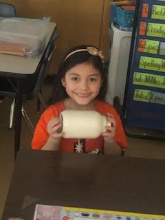 1 female Belle student shaking jar of butter
