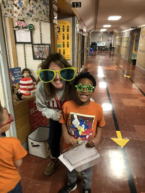 Mrs. Hodge and 1 make student wearing wacky sunglasses