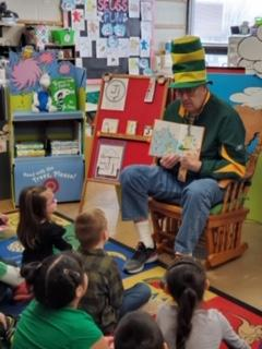 Mr. H reading Green Eggs and Ham to Belle classroom