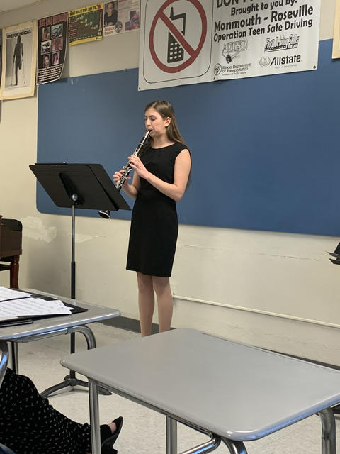 Female KHS Student playing clarinet