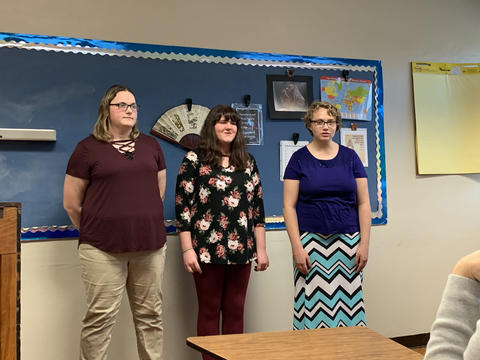 3 female KHS students singing