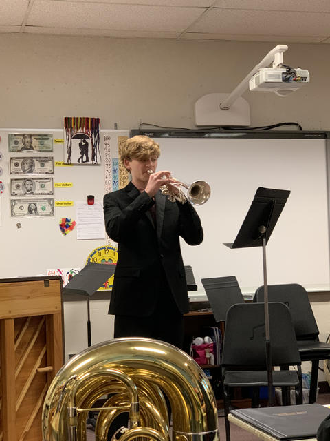 Male KHS student playing trumpet