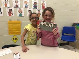 2 Female Belle Students with LEGO project