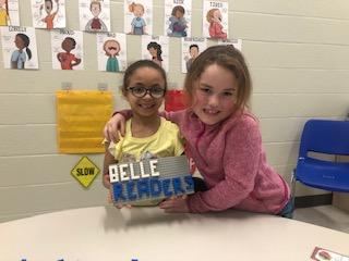 2 Female Belle Students holding up their LEGO projects