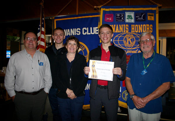 Mikey Erikson honored as Kiwanis Student of the Month holding certificate with family and Kiwanis members