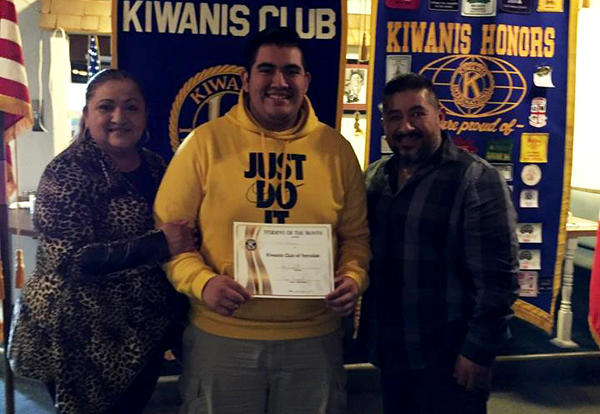 Kiwanis Student of the Month Marc Rodriguez with certificate at award presentation.