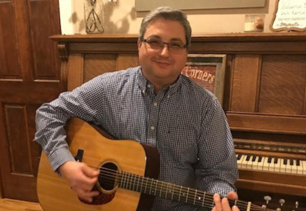 Experienced educator, Musician and lifelong learner Obadiah DeWeber set to join Skyline Staff on July 1. DeWeber is pictured here with his guitar.