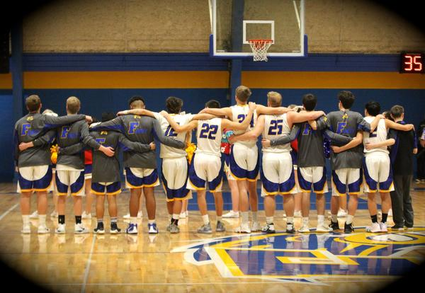 Ferndale Boys' Basketball Team standing together before tip-off