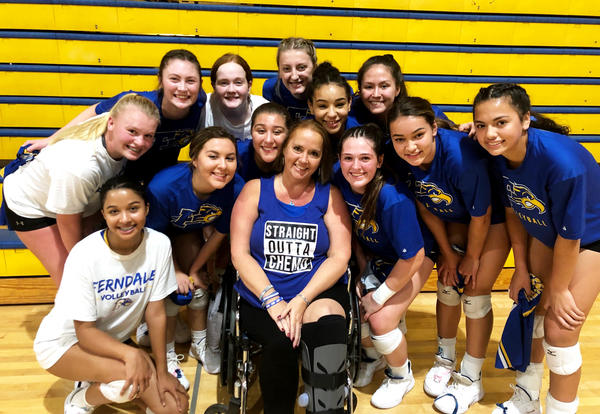 Ferndale School District Paraeducator Brenda Sims with FHS volleyball team