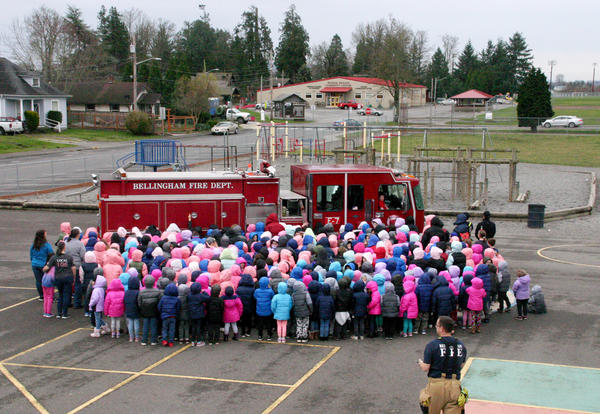 Central Elementary student in an all-school photo in front of fire truck on Central campus