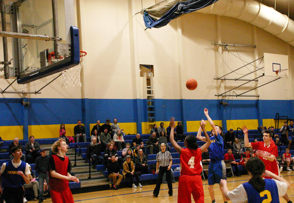 Ferndale student-athlete shooting a basket in a game