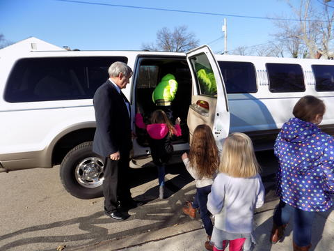 Students getting into white Hummer limo