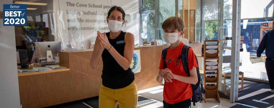 Student and teacher wearing masks