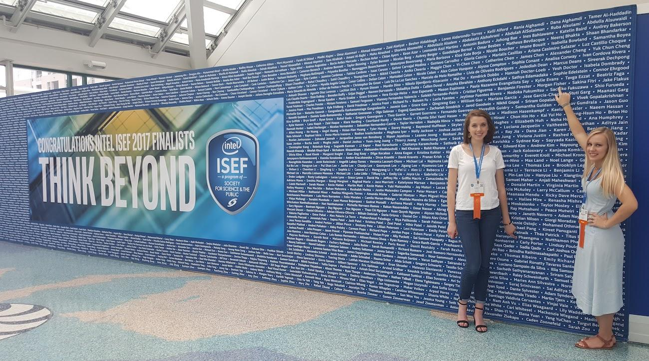 Students stand beside name wall at ISEF 2017