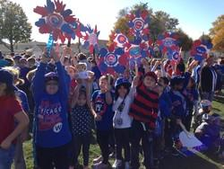 student cheering for theChicago Cubs