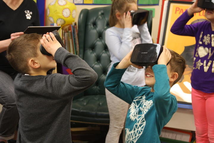 group of student exploring with Google expedition VR headset