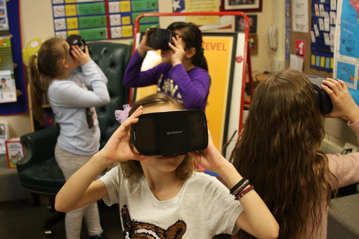 Groups of student exploring with Google expedition VR headset