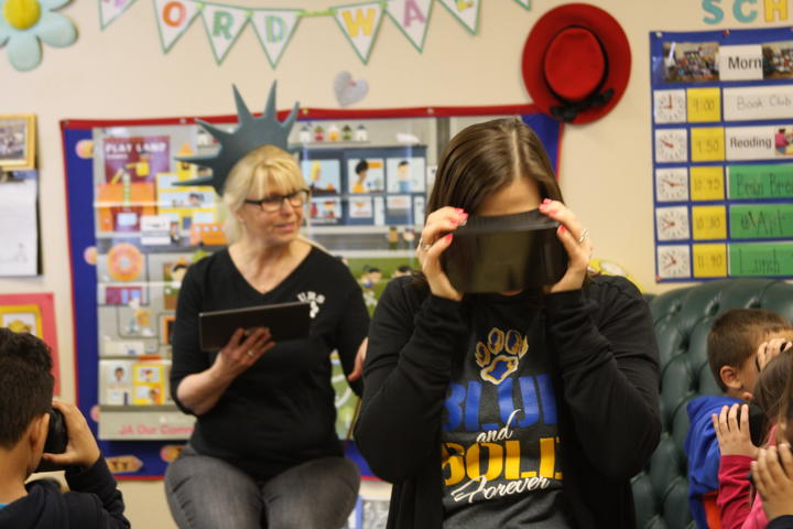 The Principal participating in Google expedition VR headset