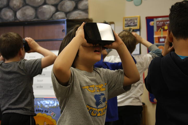 Students exploring with Google expedition VR headset