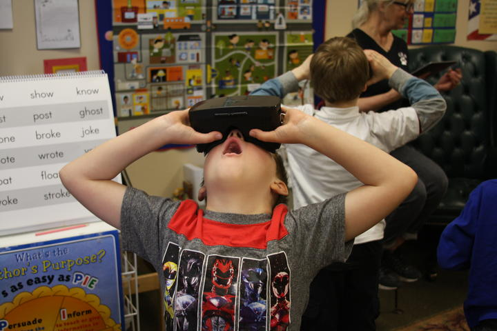 Boy amazed while using Google expedition VR headset