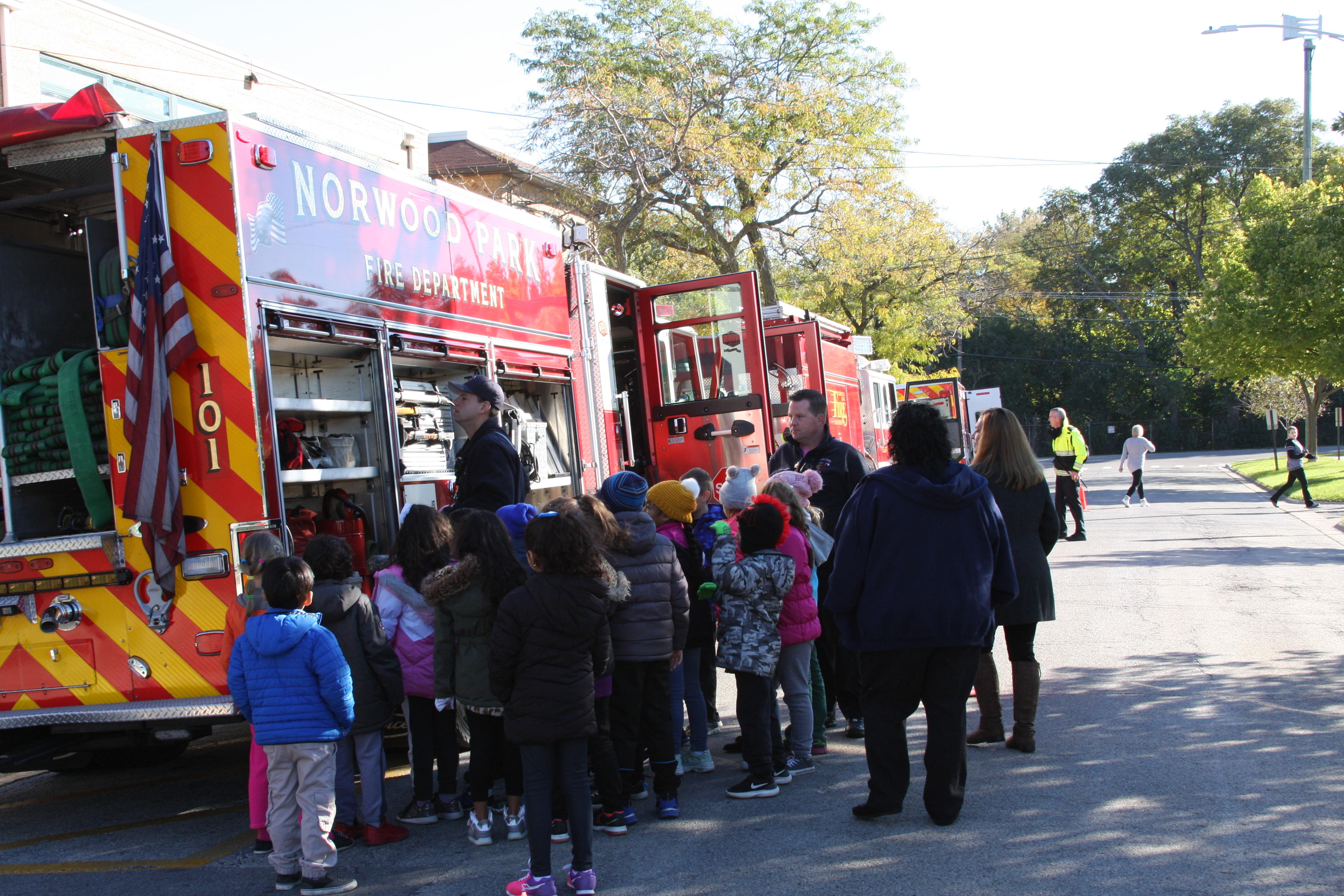 image of students observing the firefighter