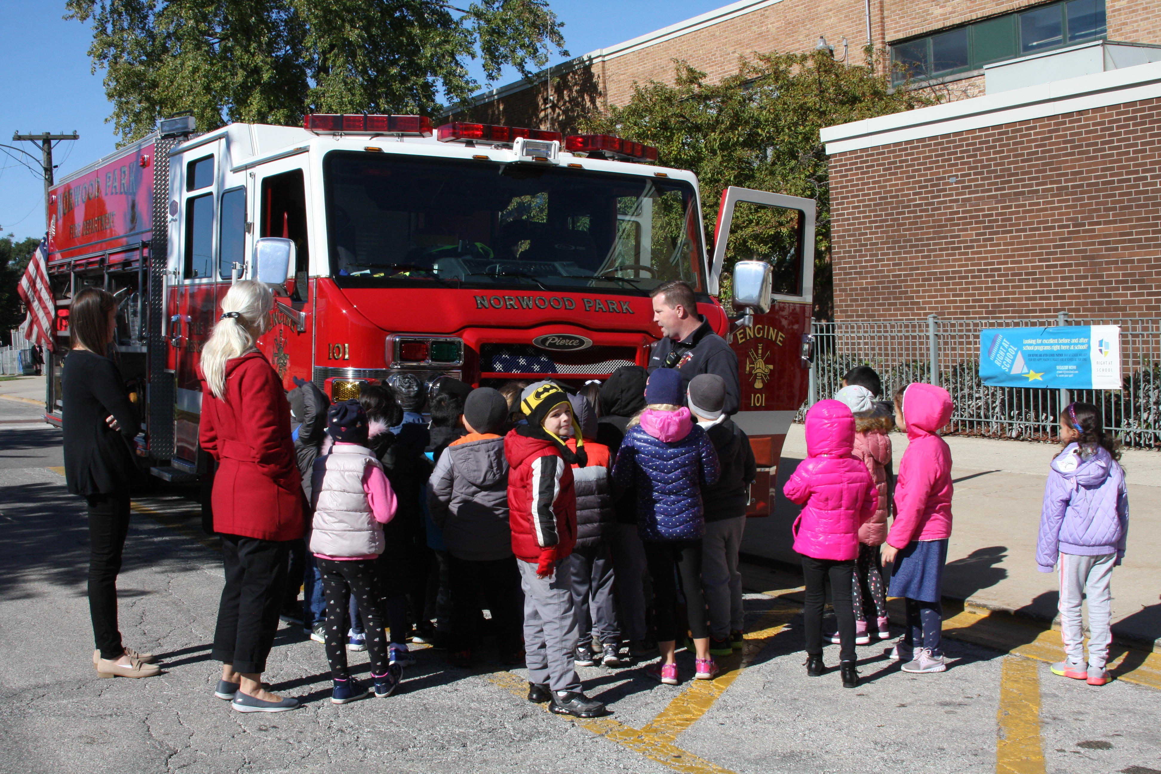 image of students standing by the fire truck