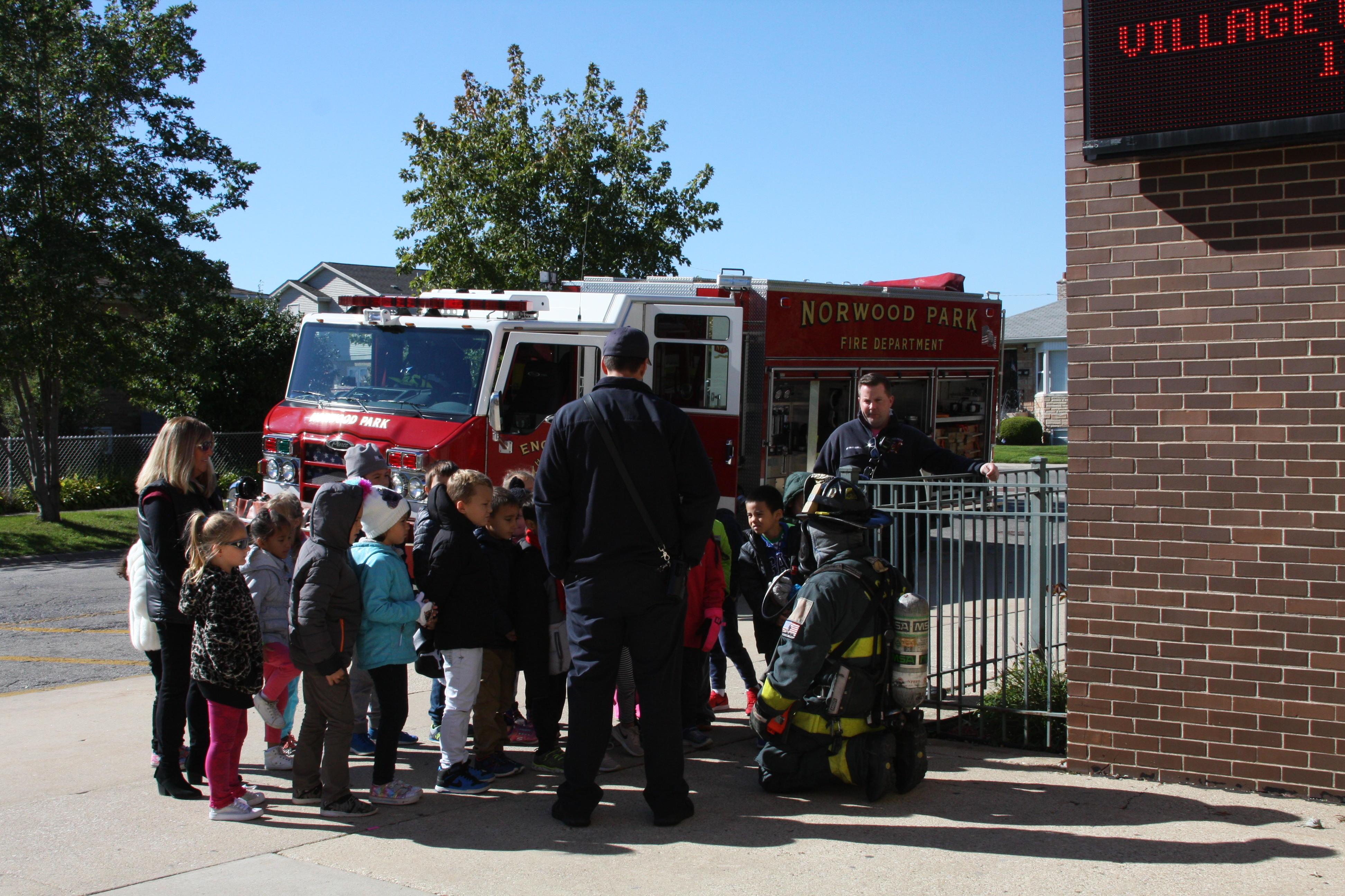image of students listening to the firefighter