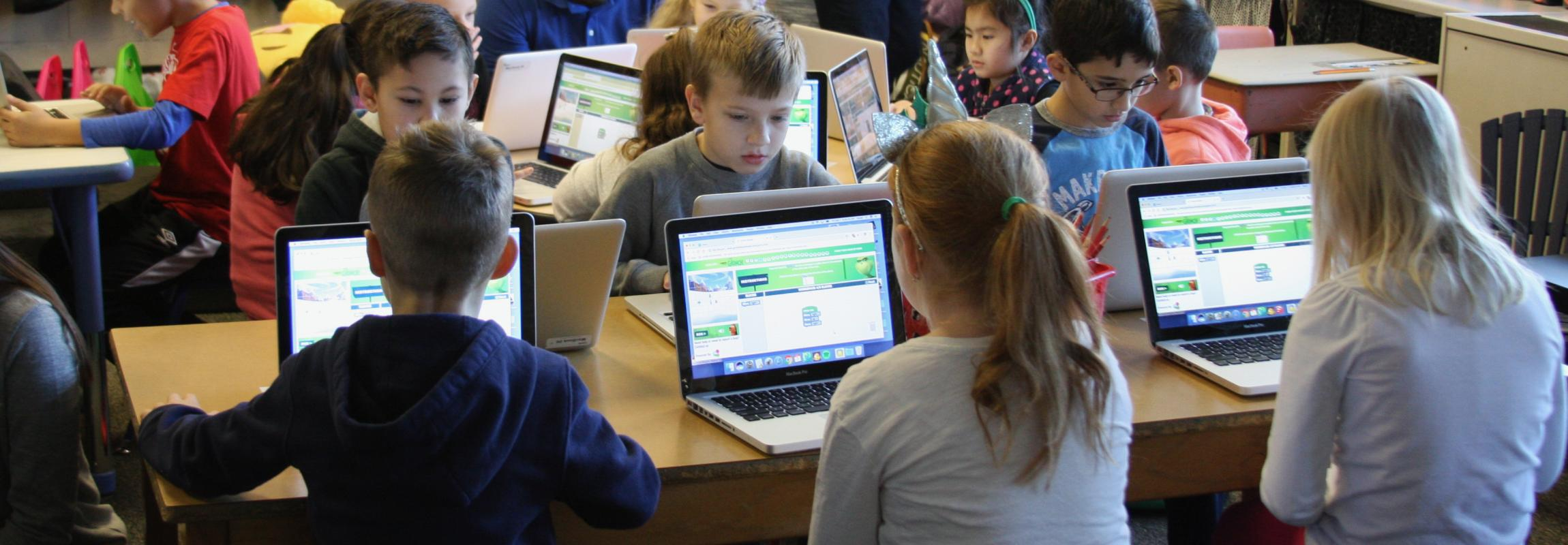 Group of 2nd grade student participate in hour of code