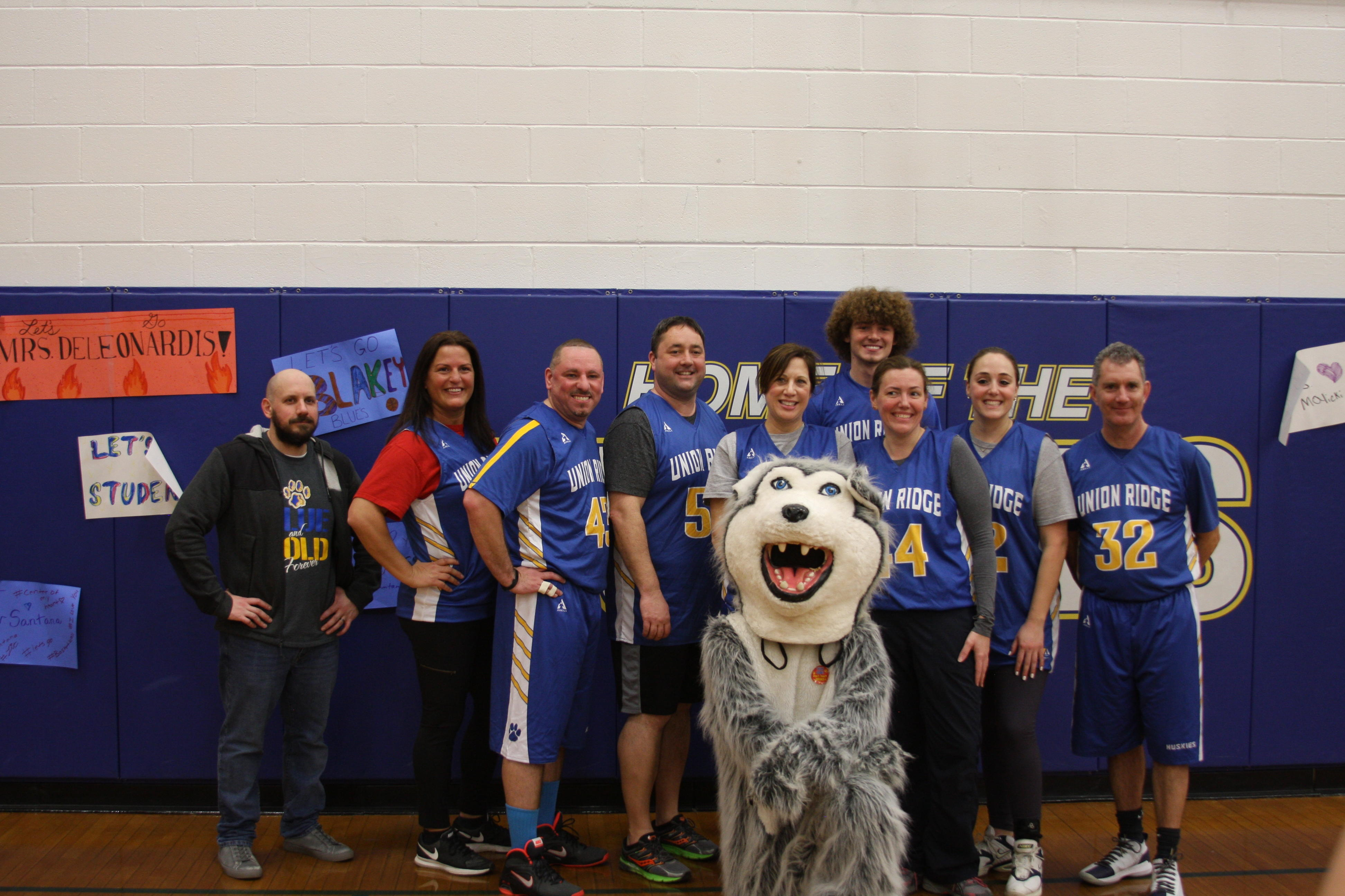 hoops for heart teacher's team posing for picture