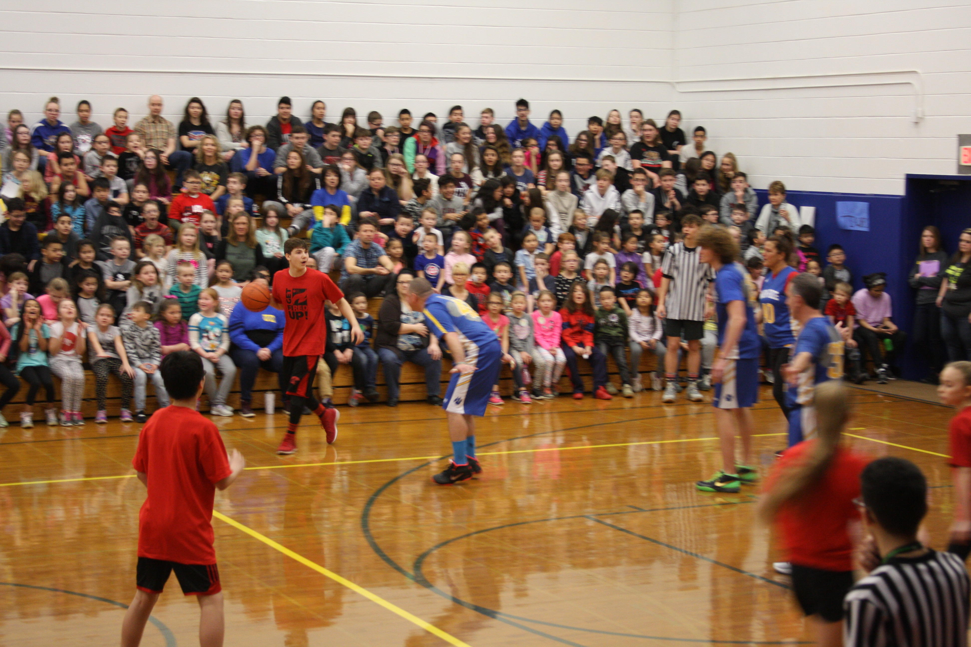 hoops for heart student about to shoot the ball