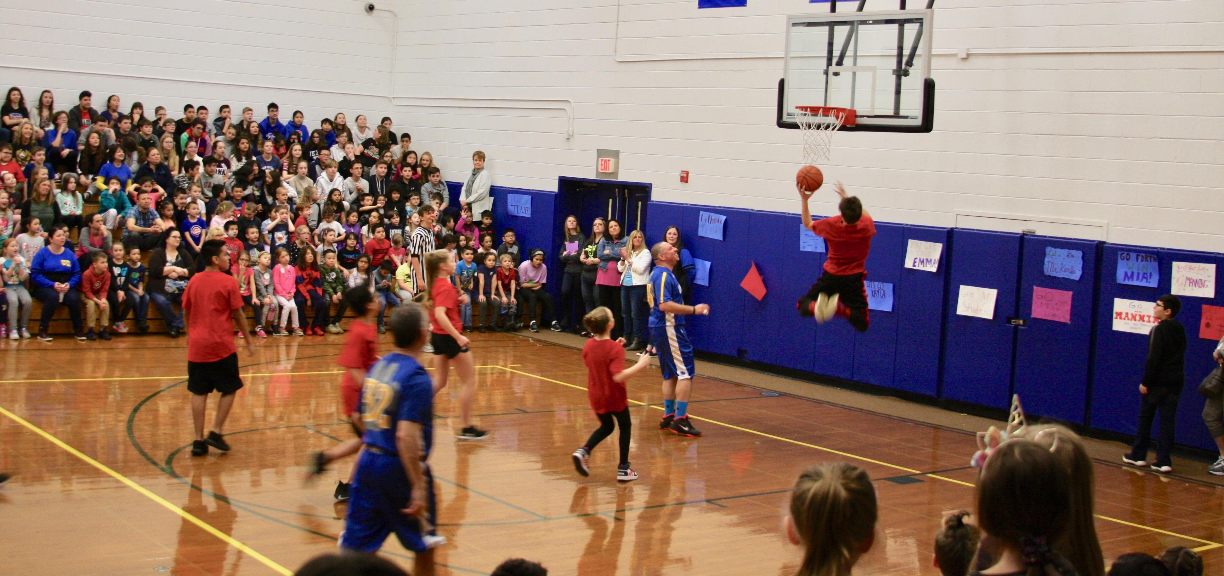 Hoops for heart student jumping to the hoop