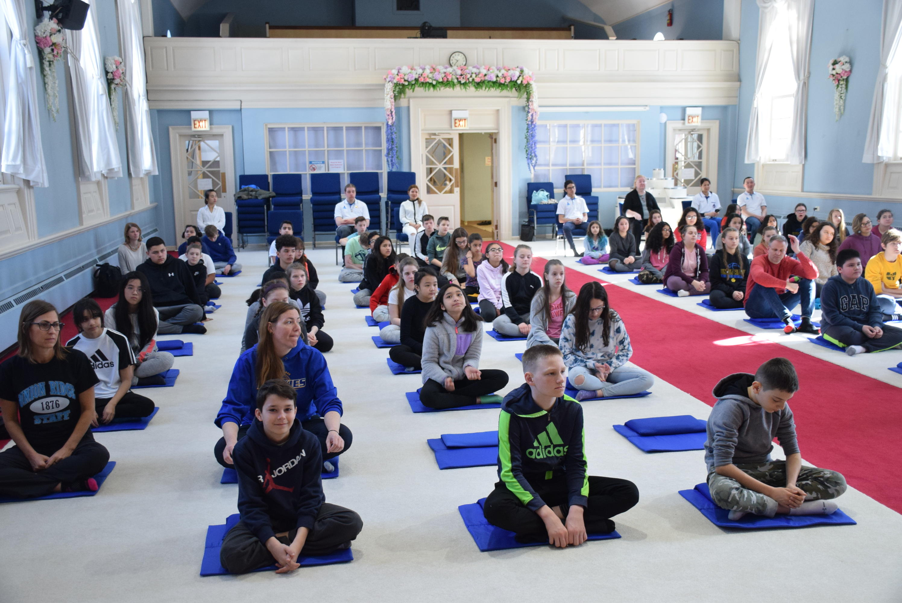 students and teachers in meditation 2