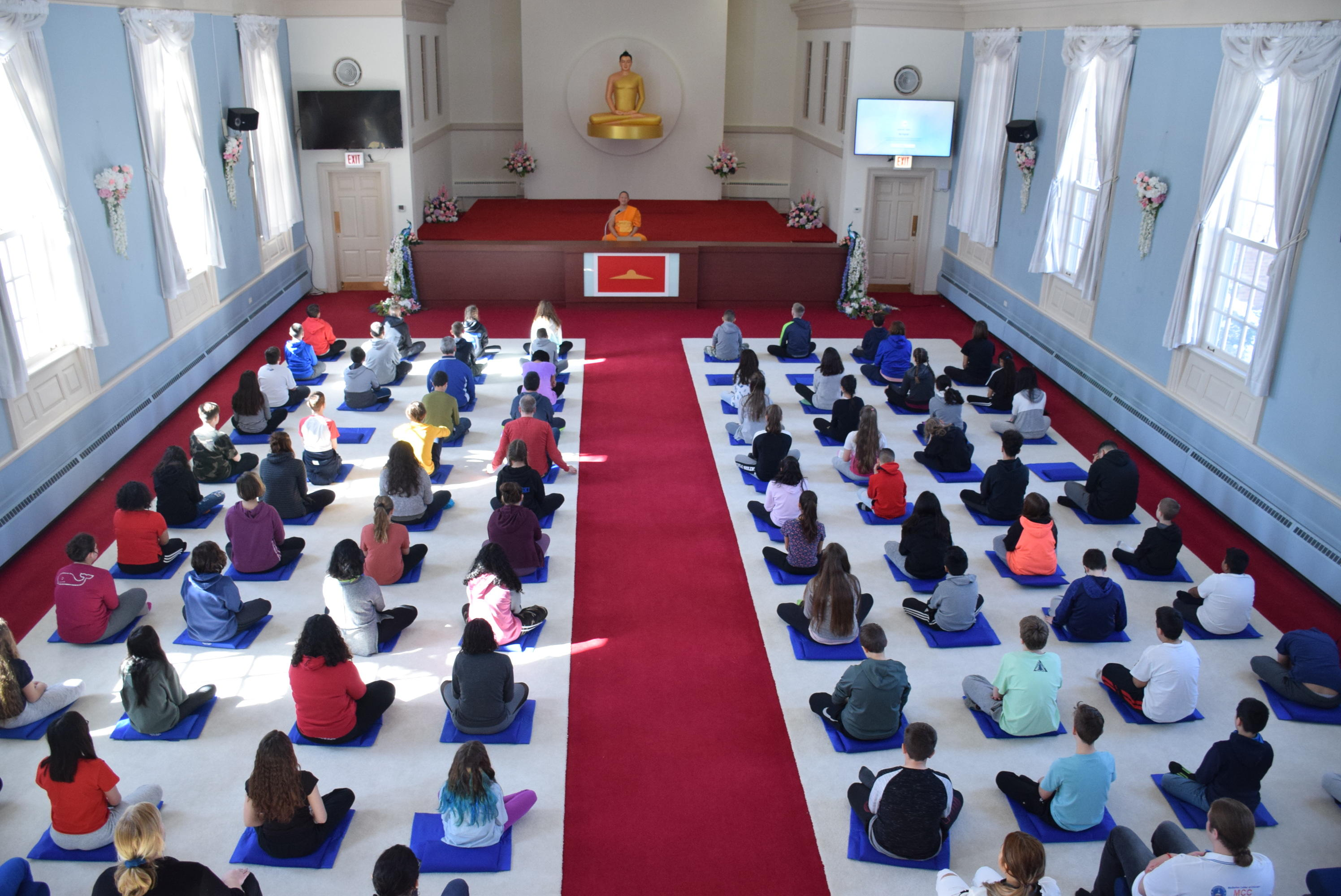students and teachers in meditation 1
