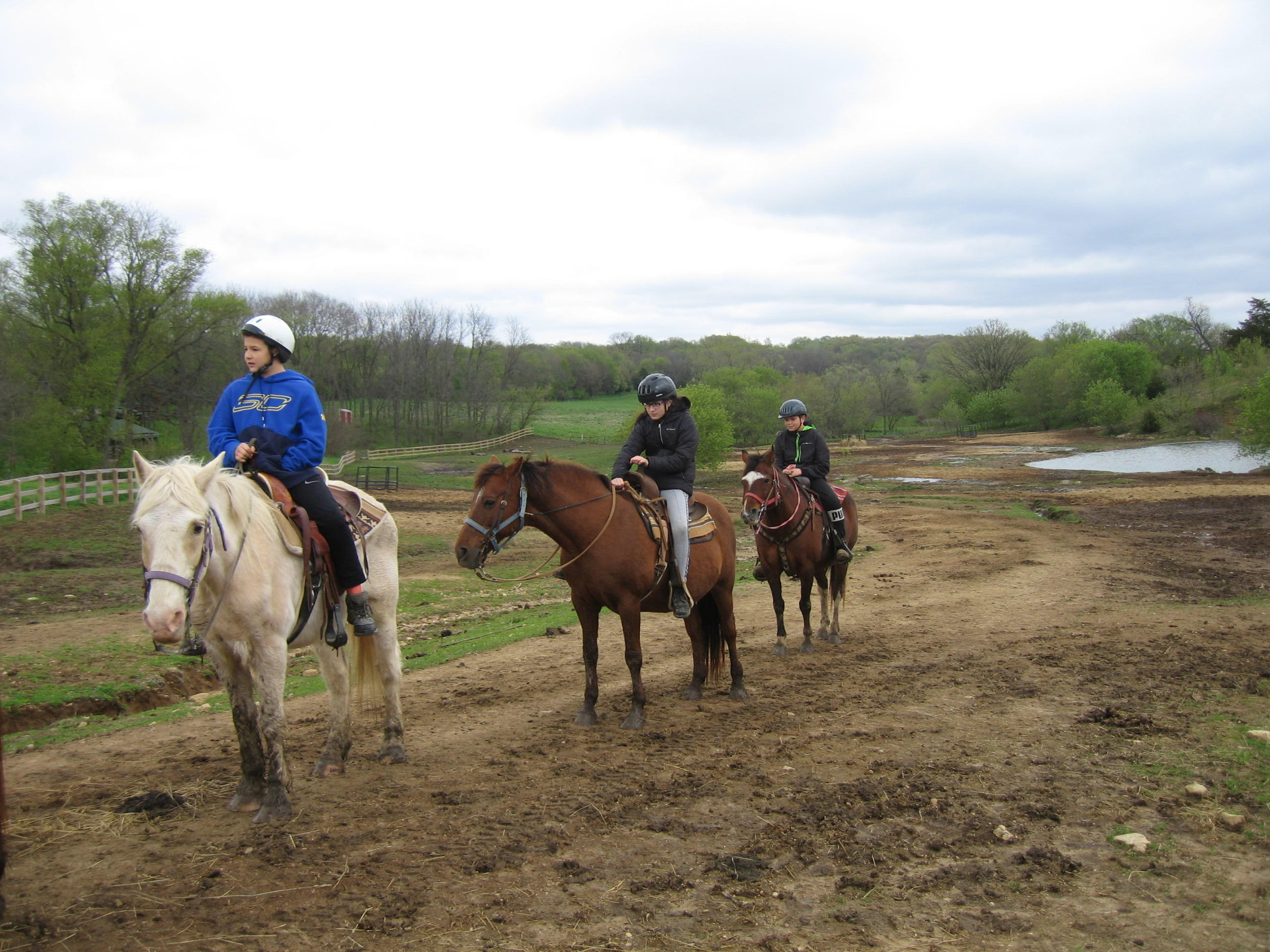 Outdoor Education Trips - Student riding horses