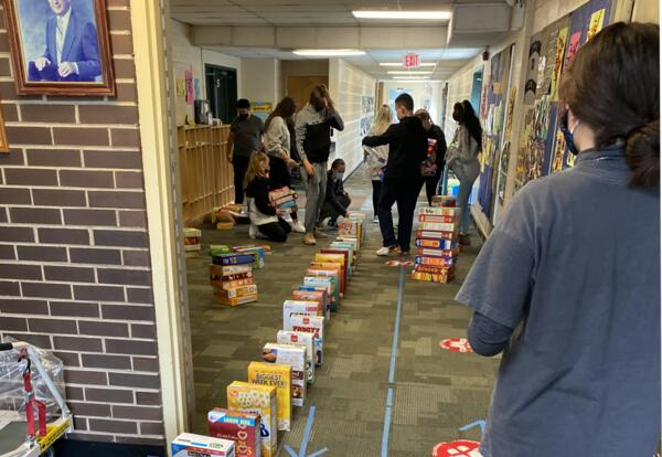 students setting up cereal box for the domino run