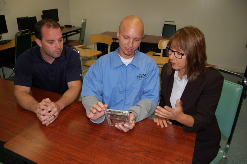 College Coordinator for Voluntary Education Program Troy Barker, FRC incarcerated student Douglas Andrews and ISP Director Dr. Joan Parkin review the efficiency of using advanced technology in education.
