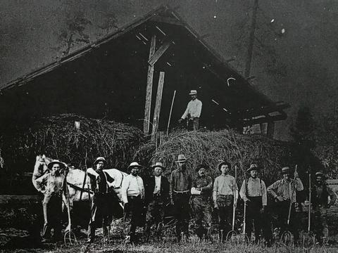 mills ranch hay crew with barn