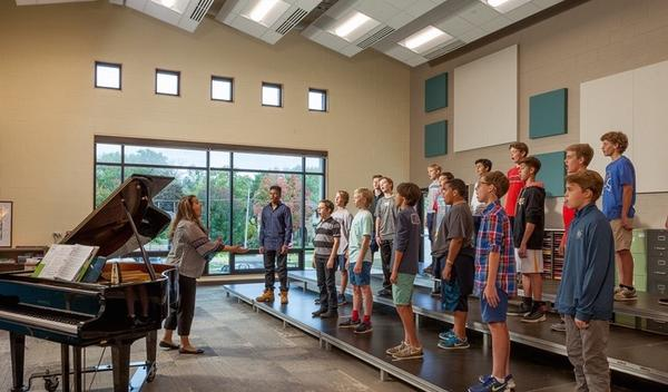 Choir room renovation with students singing