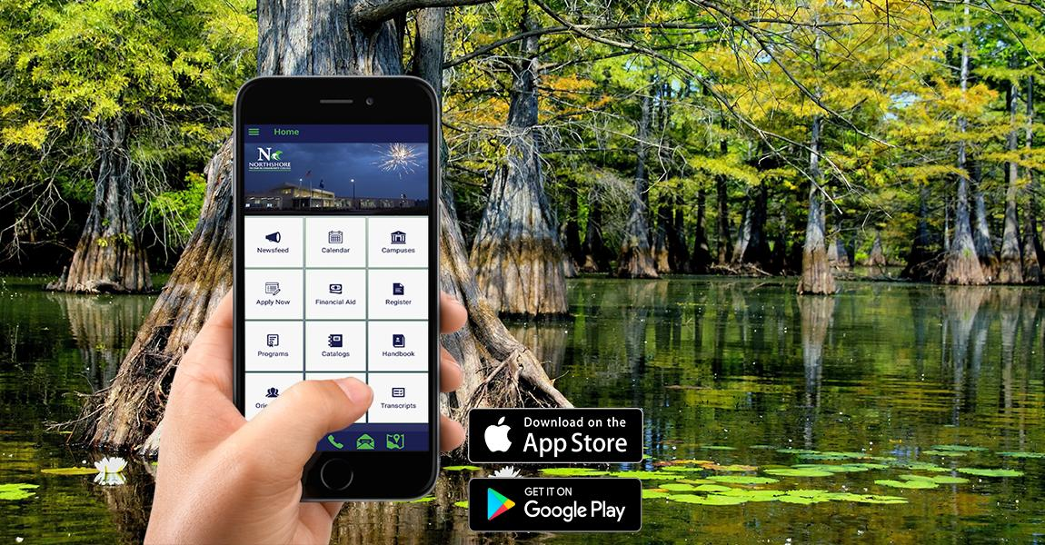 Photo of hand holding a smartphone with the college app on the screen in the middle of the bayou swamp.
