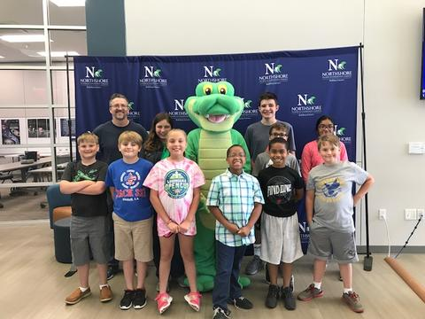 Students posing with alligator mascot