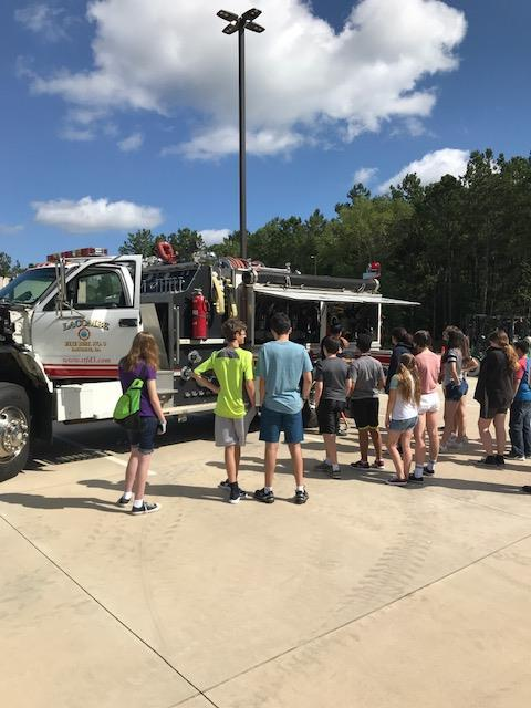 Students standing by truck