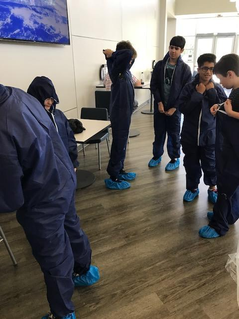 Students' feet covered in blue booties