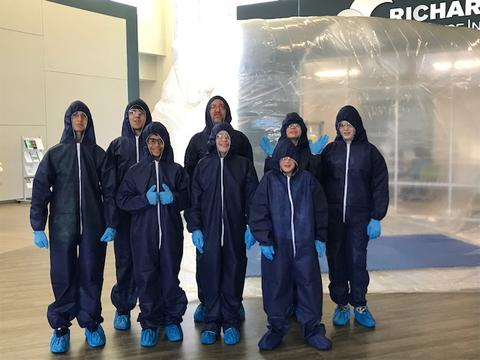 Male students posing in protective gear