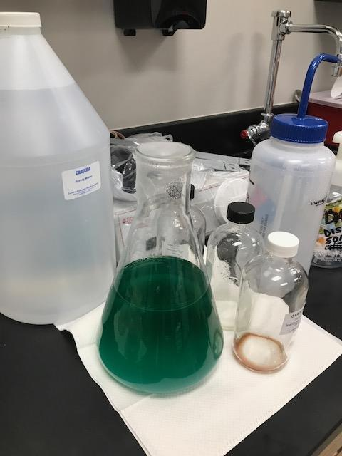 Bottles and beakers of chemicals